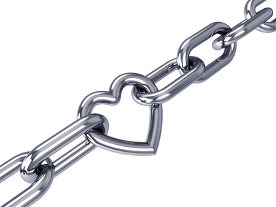 Heart link in a chrome chain, isolated on white
